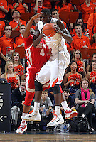 Dec. 07, 2010; Charlottesville, VA, USA;  Virginia Cavaliers center Assane Sene (5) grabs the rebound in front of Radford Highlanders guard Jareal Smith (4) during the game at the John Paul Jones Arena. Virginia won 54-44. Mandatory Credit: Andrew Shurtleff