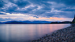 Idaho, Northern, Bonner County, Sandpoint.Lake Pend Oreille and Schweitzer Mountain after sunset in spring.