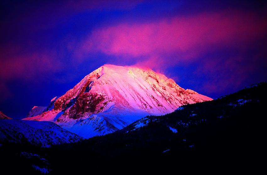 A peak near Whistler Blackcomb ski resort in alpenglow, Whistler, British Columbia, Canada