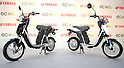 July 14, 2010 - Tokyo, Japan - Yamaha Motor's new electric commuter vehicle EC-03 is displayed in Tokyo, Japan, on July 14, 2010. Yamaha Motor will begin selling from September 1 in the Tokyo area and nationwide from October 1, then will introduce the EC-03 in the markets of Taiwan and Europe in 2011. The 240,000 yen ($2,700) &quot;smart minimal commuter&quot; achieves a running distance per charge of 43 km, powered by 50V lithium-ion battery manufactured by Sanyo.