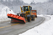 Snow removal after a snow storm along the Kancamagus Highway (route 112), which is one of New England's scenic byways. Located in the White Mountains, New Hampshire USA.