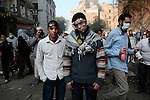 Protesters stand by on Mohamed Mahmoud street near Tahrir Square during stand off and clashes with riot police on November 22, 2011 in Cairo, Egypt.
