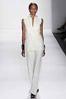 Model walks runway an IVORY ITALIAN SILK DUPIONI SLEEVELESS D/B BLAZER.W/ ATTACHED UPTURNED PEAK LAPEL + HAND TOP HAND STITCHING, AND  IVORY ITALIAN SILK DUPIONI TROUSERS by Zang Toi, for the Zang Toi Spring 2012 My Dream Of North Africa Collection, during Mercedes-Benz Fashion Week Spring 2012.
