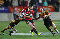 Chiefs' Aaron Cruden, left, and Andrew Horrell tackle Crusaders' Ryan Crotty in the semi-final Super Rugby match, Waikato Stadium, Hamilton, New Zealand, Friday, July 27, 2012.  Credit:SNPA / David Rowland