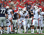 Auburn defensive lineman Gabe Wright (90) celebrates stopping Ole Miss on 4th and 1 at Vaught-Hemingway Stadium in Oxford, Miss. on Saturday, October 13, 2012. (AP Photo/Oxford Eagle, Bruce Newman)..