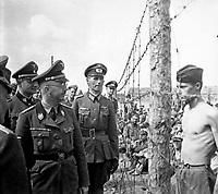 Himmler besichtigt die Gefangenenlager in Russland.  Heinrich Himmler inspects a prisoner-of-war camp in Russia.  Ca. 1940-41.  Heinrich Hoffman Collection.  (Foreign Record Seized)<br /> Exact Date Shot Unknonw<br /> NARA FILE #:  242-HB-47721-306<br /> WAR &amp; CONFLICT BOOK #:  1275