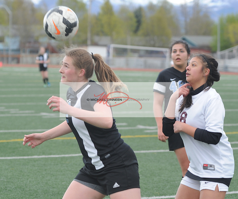Chugiak's Autumn Parrish heads the ball in front of  her Dimond opponent in the second half of their JV soccer contest Tuesday, April 26 at Dimond.  Photo for the Star by Michael Dinneen