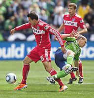Chicago Fire forward Marco Pappa collides withe Seattle Sounders FC midfielder Osvaldo Alonso  during play at Qwest Field in Seattle Tuesday April 8, 2011. The Sounders won the game 2-1.