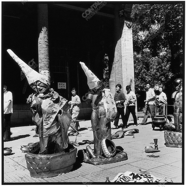 Destruction inside the Jile Temple; Red Guards placed paper dunce caps on sculptures of the Buddha; Harbin, Heilongjiang Province, August 24, 1966