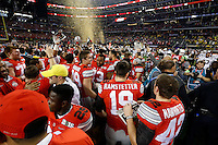 Ohio State Buckeyes celebrate after beating Oregon Ducks 42-20 in College Football Playoff Championship game at AT&T Stadium in Arlington, Texas on January 12, 2015.  (Dispatch photo by Kyle Robertson)