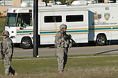 Fort Hood, TX - November 5, 2009 -- A soldier stands guard outside a Mobile Command Post at Fort Hood, Texas, Thursday, November 5, 2009, following a gunman's attack that left 13 dead and 30 wounded.  .Mandatory Credit: U.S. Army via CNP