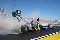 Mar. 16, 2013; Gainesville, FL, USA; NHRA top fuel dragster driver Sidnei Frigo during qualifying for the Gatornationals at Auto-Plus Raceway at Gainesville. Mandatory Credit: Mark J. Rebilas-