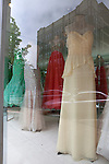 Festive prom and party dresses in a shop window in Michigan City, Indiana, USA