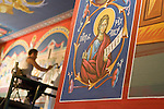 St. Sava frescos by Miloje Milinkovic..Miloje pains the wall above a stained glass window
