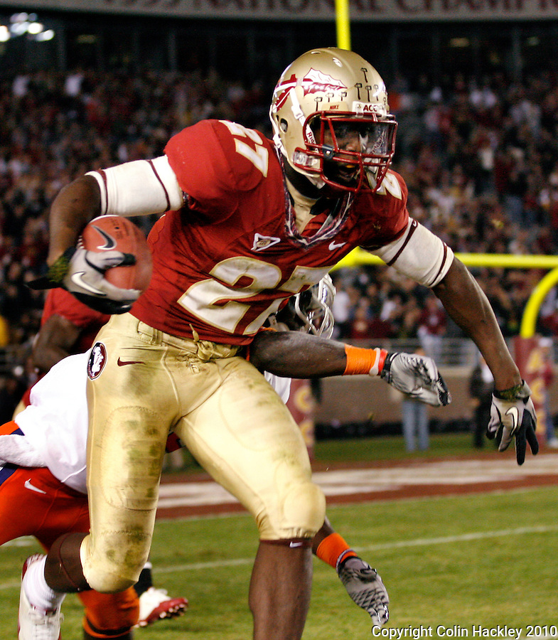 TALLAHASSEE, FL 11/13/10-FSU-CLEMSON FB10 CH-Florida State's Xavier Rhodes is pushed out of bounds by Clemson's Michael Wade after Rhodes intercepted a pass  in the fourth quarter against Clemson Saturday at Doak Campbell Stadium in Tallahassee. The Seminoles beat the Tigers 16-13..COLIN HACKLEY PHOTO
