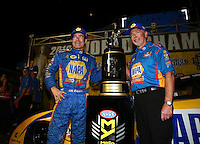 Nov 12, 2016; Pomona, CA, USA; NHRA funny car driver Ron Capps celebrates with crew after clinching the 2016 funny car world championship during qualifying for the Auto Club Finals at Auto Club Raceway at Pomona. Mandatory Credit: Mark J. Rebilas-USA TODAY Sports