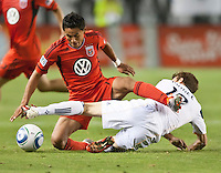 CARSON, CA – June 3, 2011: DC United midfielder Andy Najar (14) and LA Galaxy midfielder Mike Magee (18) battle for the ball during the match between LA Galaxy and DC United at the Home Depot Center in Carson, California. Final score LA Galaxy 0, DC United 0.
