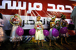 Egyptian girls line the front of the stage at a rally for Egyptian Islamist presidential candidate Dr. Mohamed Morsy May 17, 2012 in the Nile delta city of Benha, Egypt. Morsy, the Muslim Brotherhood's candidate once lagged far behind in the polls, but is now considered a strong underdog candidate because of the legendary organizational machine his group commands during election times. (Photo by Scott Nelson)