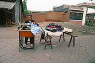 October 1984. Shang Xi Province, near Cheng Du, an independant clothes maker, she will sell directly her production to the pedestrians.