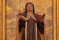 Statue of St Teresa with the Holy Spirit, from the altarpiece in the Capilla de Santa Teresa da Avila, 17th century, in Granada Cathedral, or the Cathedral of the Incarnation, built 16th and 17th centuries in Renaissance style with Baroque elements, Granada, Andalusia, Southern Spain. Several architects worked on the cathedral, which, unusually, has 5 naves and a circular capilla mayor instead of an apse. Granada was listed as a UNESCO World Heritage Site in 1984. Picture by Manuel Cohen