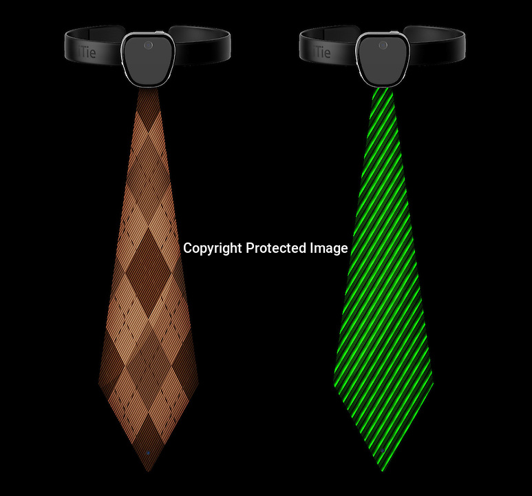 BNPS.co.uk (01202 558833)<br /> Pic: TomislavZvonaric/BNPS<br /> <br /> ****Please use full byline****<br /> <br /> A tie has been created for fashion conscious men that is fully interactive and can change pattern or colour at the touch of a button.<br /> <br /> The accessory is made with a flexible screen that can link up with IOS apps such as the ones found on an iPad or iPhone.<br /> <br /> Owners of the tie could download a special app which would then display a different fabric or design every time it was 'swiped'.<br /> <br /> The gadget, dubbed the iTie, would also be able to make phone calls, send texts, and have Skype conversations.<br /> <br /> It would be built with a camera at the bottom and also one at the top where it is fastened to create two webcam views.<br /> <br /> The concept for the accessory has been created by Tomislav Zvonaric, 33, a graphic designer from Zagreb in Croatia.