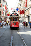 Street car and pedestrians on shopping street in Taksim district of Istanbul