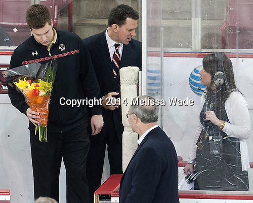 Kevin Pratt (BC - Student Manager), Matt Conway (BC - Assistant AD-Ops), Tom Peters (BC - Senior Associate AD), Katie Foley - The visiting University of Notre Dame Fighting Irish defeated the Boston College Eagles 2-1 in overtime on Saturday, March 1, 2014, at Kelley Rink in Conte Forum in Chestnut Hill, Massachusetts.