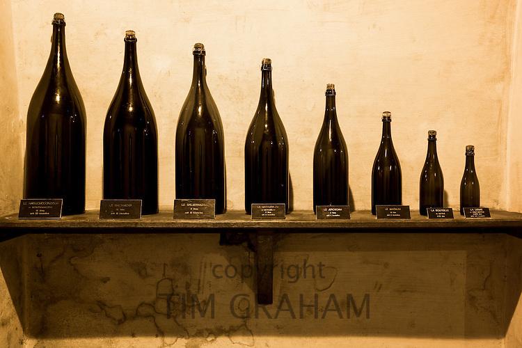 Demie, Magnum, Jeroboam, Methusalem, Balthazar, Salmanazar, Nebuchadnezzar bottles at Champagne Taittinger in Reims, France