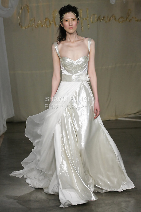 Model walks runway in a Carolina Silver Bell wedding dress by Carol Hannah Whitfield, for the Carol Hannah Spring Summer 2012 Bridal collection runway show.