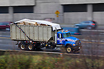 Truck Hauling construction waste on Rt. I-95 on a rainy day, Richmond Virginia NO RELEASE