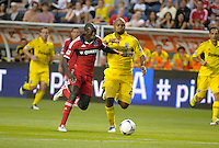 Chicago forward Dominic Oduro (8) gains position on Columbus defender Julius James (26) en route to scoring Chicago's second goal.  The Chicago Fire defeated the Columbus Crew 2-1 at Toyota Park in Bridgeview, IL on June 23, 2012.