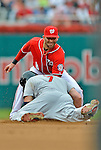 2 September 2012: Washington Nationals' second baseman Danny Espinosa applies a tag on a sliding Matt Holliday during a game against the St. Louis Cardinals at Nationals Park in Washington, DC. The Nationals edged out the visiting Cardinals 4-3, capping their 4-game series with three wins. Mandatory Credit: Ed Wolfstein Photo