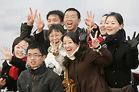 A group of friends poses for a photograph on the famous 'Bund' waterfront of Shanghai, China, on January 8, 2009. Photo by Lucas Schifres/Pictobank