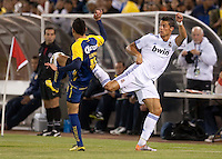 Cristiano Ronaldo (right) tries to kick the ball against Oscar Rojas (left). Real Madrid defeated Club America 3-2 at Candlestick Park in San Francisco, California on August 4th, 2010.