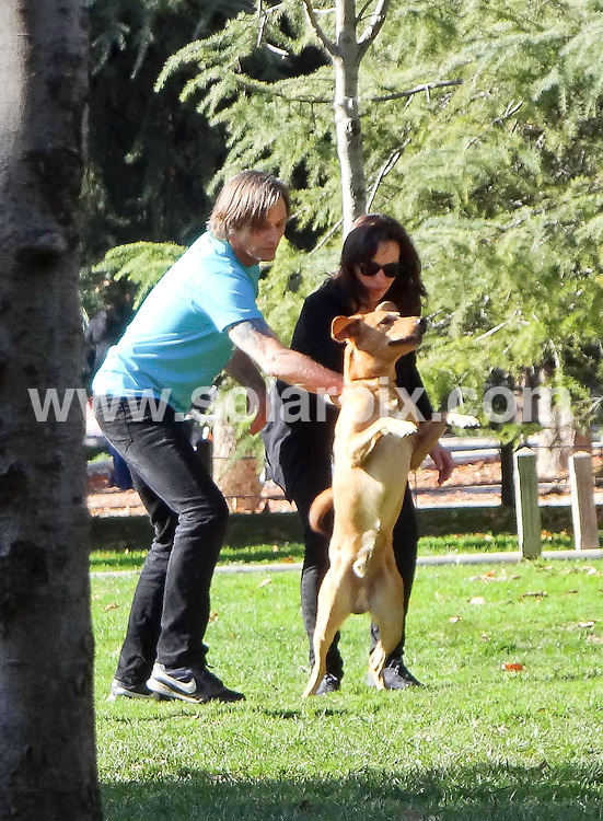 **ALL ROUND EXCLUSIVE PICTURES FROM SOLARPIX.COM** **DOUBLE SPACE RATES APPLY**                                              **WORLDWIDE SYNDICATION RIGHTS APART FROM SPAIN** .Viggo Mortensen out and about in the streets of Madrid, with the new woman in his life, Ariadna Gil. The couple played football in the park with their dog and later on, Viggo took the dog for another walk on his own and returned with a bunch of flowers for Ariadna..Viggo reportedly met the Spanish actress on the set of 2008's Appaloosa..This pic:    Viggo Mortensen & Ariadna Gil                                                      .JOB REF:   14306   MPP       DATE:   20.12.11                                           **MUST CREDIT SOLARPIX.COM OR DOUBLE FEE WILL BE CHARGED**                                                                      **MUST AGREE FEE BEFORE ONLINE USAGE**                               **CALL US ON: +34 952 811 768 or LOW RATE FROM UK 0844 617 7637**