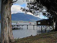 Helicopter on helipad jutting out unto Lake Te Anau, at Te Anau, South Island, New Zealand, 101004050043. Helicopter trips are a very popular way to see otherwise inaccessible landscapes,..Copyright Image from Victor Patterson, 54 Dorchester Park, Belfast, United Kingdom, UK. Tel: +44 28 90661296. Email: victorpatterson@me.com; Back-up: victorpatterson@gmail.com..For my Terms and Conditions of Use go to www.victorpatterson.com and click on the appropriate tab.