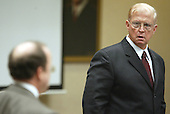Prince William County (Virginia) prosecutor Paul Ebert, right, looks back at defense attorney Peter Greenspun, left, suring the trial of sniper suspect John Allen Muhammad in Virginia Beach Circuit Court in Virginia Beach, Virginia on November 7, 2003. <br /> Credit: Tracy Woodward - Pool via CNP