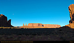 Three Sisters and Mitchell Mesa at Sunrise, Monument Valley Navajo Tribal Park, Navajo Nation Reservation, Utah/Arizona Border