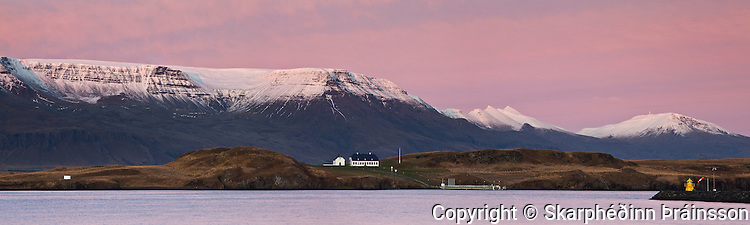 A panorama view of Island Viðey in Faxaflói, Mt. Esja and Móskarðhnjúkar in background
