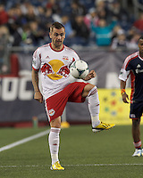 New York Red Bulls midfielder Jonny Steele (22) controls the ball. In a Major League Soccer (MLS) match, the New England Revolution (blue) tied New York Red Bulls (white), 1-1, at Gillette Stadium on May 11, 2013.