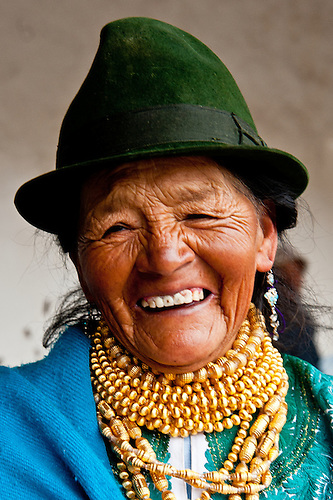 An elderly woman proudly delivers milk from her two cows to the quality testing facility in the Andes of Ecuador.