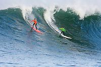 Jamie Sterling and Evan Slater shred a wave at  Mavericks Surf Contest 2008.  Half Moon Bay, Ca.  January 12, 2008.