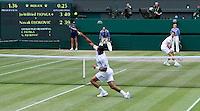JO-WILFRED TSONGA (FRA) (12) against NOVAK DJOKOVIC (SRB) (2) in the Semi-Finals of the Gentlemen's Singles. Novak Djokovic beat Jo-Wilfred Tsonga 7-6 6-2 6-7 6-3..Tennis - Grand Slam - Wimbledon - AELTC - London- Day 11 - Fri July 1st 2011..© AMN Images, Barry House, 20-22 Worple Road, London, SW19 4DH, UK..+44 208 947 0100.www.amnimages.photoshelter.com.www.advantagemedianetwork.com.