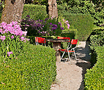 Stone table in the baroque garden of Hotel Palazzo Salis built in 1630 by the knight Battista in Solgio; the garden of the hotel dates back to 1701 and is home to two giant sequoia trees; Graubunden Canton of Switzerland