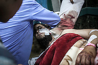 In this Monday, Jul. 08, 2013 photo, a wounded man is wheeled from the intense care ward after arrived to the Medinet Nasr Atamineh Sah hospital from Republican Guard heardquarters were got shot allegedly by Egyptian army forces in Cairo, Egypt. (Photo/Narciso Contreras).