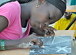 Alcius Miguelita, 12, and other children in Port-au-Prince participate in an art program sponsored by Viva Rio, a Brazilian nongovernmental organization whose work with survivors of the January 12 earthquake is supported by the ACT Alliance.