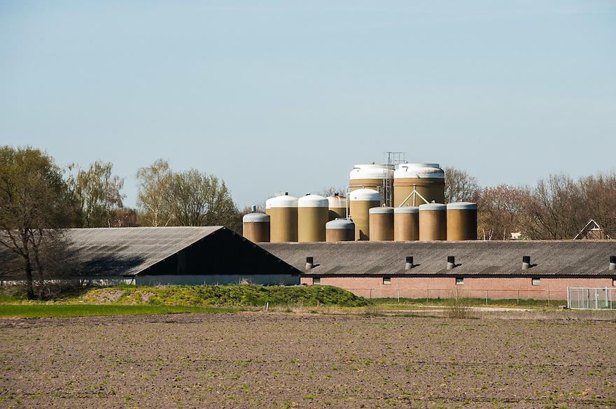 Nederland, omgev.Sint Anthonis, 20 april 2015<br /> Grote stallen en voedersilo's in het brabantse landschap. <br /> <br /> Foto: Michiel Wijnbergh