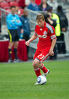 22 May 2010: Toronto FC midfielder Jacob Peterson #23 in action during a game between the New England Revolution and Toronto FC at BMO Field in Toronto..Toronto FC won 1-0.....