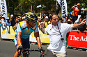 Lance Armstrong finishes the race and is under direction from Team Astana Press Officer at Stage 6 of the Tour Down Under Pro Tour race on Sunday, January 25, 2009 in Adelaide Australia