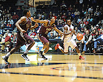"Ole Miss' Derrick Millinghaus (3) vs. Arkansas Little Rock's Amos Studivant (15) at the C.M. ""Tad"" Smith Coliseum in Oxford, Miss. on Friday, November 16, 2012. Ole Miss won 92-52."